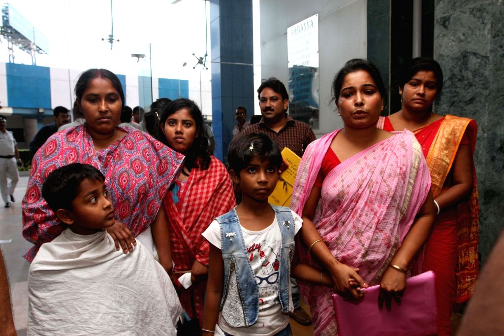 Family members of Khokon Sikdar and Samar Tikadar who where killed by the Islamic State in Iraq's Mosul in 2014; arrive to meet West Bengal Chief Minister Mamata Banerjee at Nabanna in Howrah ... - Mamata Banerjee