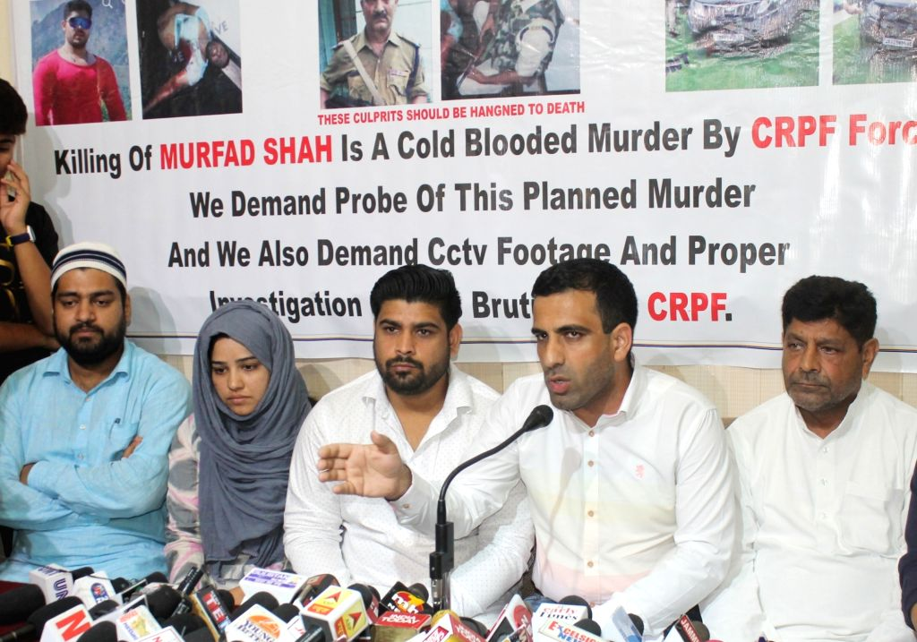 Family members of late Murfad Hussain Shah addresses a press conference at Press Club, in Jammu, on Aug 7, 2018. Murfad Hussain Shah was driving a black SUV. He drove through the outer gate, ... - Murfad Hussain Shah and Morifat Khan