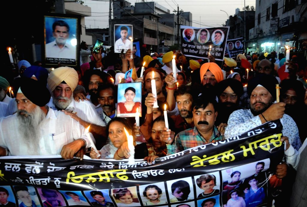 Family members of the victims of the Amritsar train tragedy where a local train crushed at least 60 people and left 72 injured while watching the burning of a Ravana effigy during Dusehra ... - Bikram Singh Majithia
