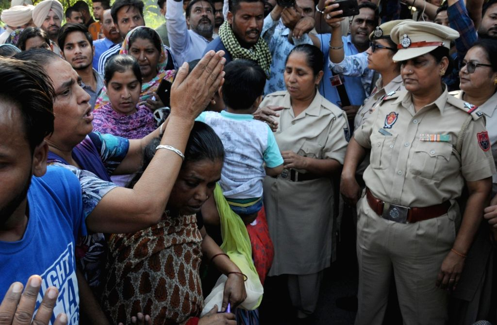 Family members of the victims of the Amritsar train tragedy where a local train crushed at least 60 people and left 72 injured while watching the burning of a Ravana effigy during Dussehra ...