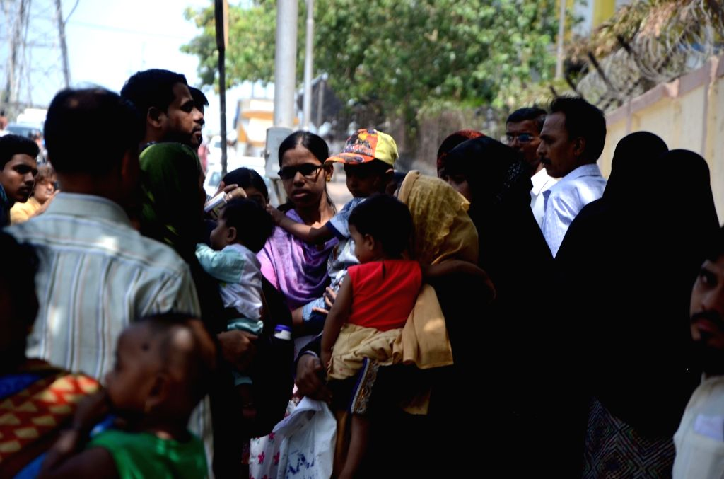 Family members of unattended patients wait outside Sion hospital after doctors of the hospital went on strike to protest against the incident where two resident doctors of JJ Hospital were ...