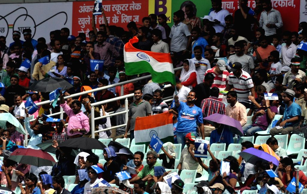Fans cheer on the third day of the Second Test Match between India and New Zealand at Eden Gardens in Kolkata on Oct 2, 2016.