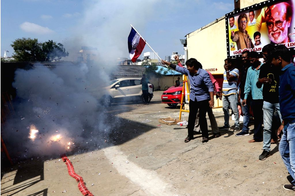 "Fans of actor Rajinikanth burn firecrackers as they celebrate the release of his film ""Darbar"", outside a theatre in Chennai on Jan 9, 2020. - Rajinikanth"