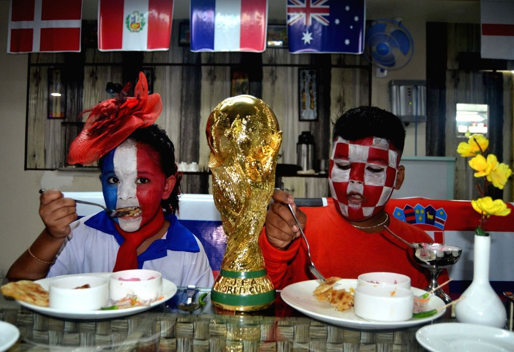 Fans of France and Croatia ahead of FIFA World Cup Finals in Kolkata, on July 13, 2018.