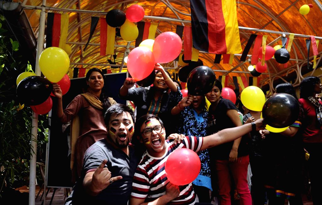 Fans of German football team celebrate after the team won FIFA World Cup Finals against Argentina, in Kolkata on July 14, 2014.