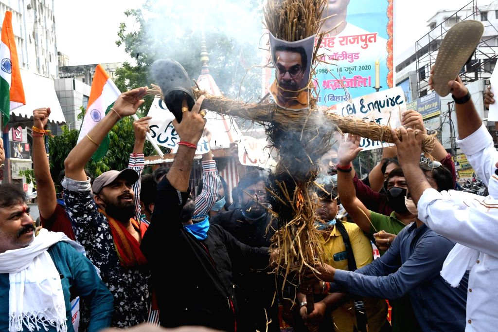 Fans of late actor Sushant Singh Rajput burn an effigy of Maharashtra Chief Minister Uddhav Thackeray as they protest demanding CBI enquiry into the actor's death, in Patna on Aug 1, 2020. - Sushant Singh Rajput