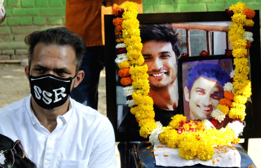 Fans of late actor Sushant Singh Rajput protest against the Government at Jantar Mantar in New Delhi on Oct 7, 2020. A week after the AIIMS-Delhi submitted its report to the CBI in ... - Sushant Singh Rajput and Rishi Kumar Shukla