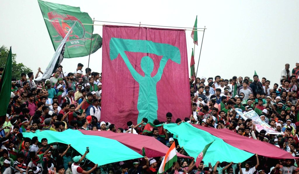 Fans of Mohun Bagan A.C. celebrate after the team's win against Calcutta Customs in the Calcutta Football League Premier Division A match at Mohun Bagan Ground, in Kolkata on Sept 12, 2018.