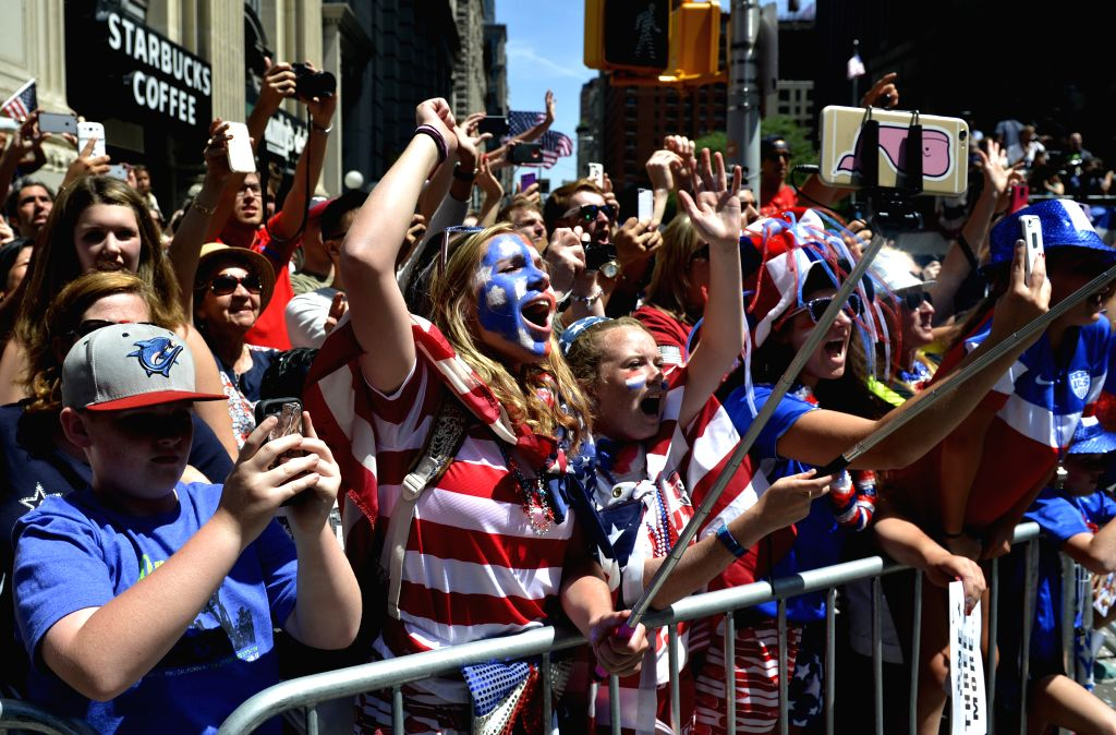 Fans of women's soccer team of the United States cheer during a celebration in New York, the United States, on July 10, 2015. The United States defeated Japan with ...