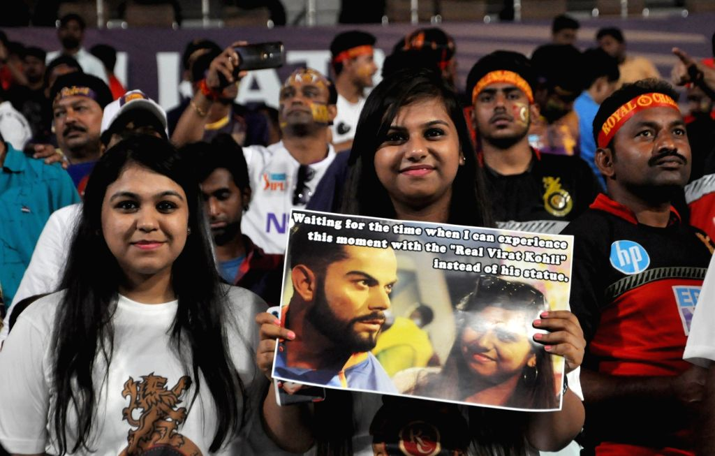 Fans perform during the 35th match of IPL 2019 between Kolkata Knight Riders and Royal Challengers Bangalore at Eden Gardens in Kolkata on April 19, 2019.