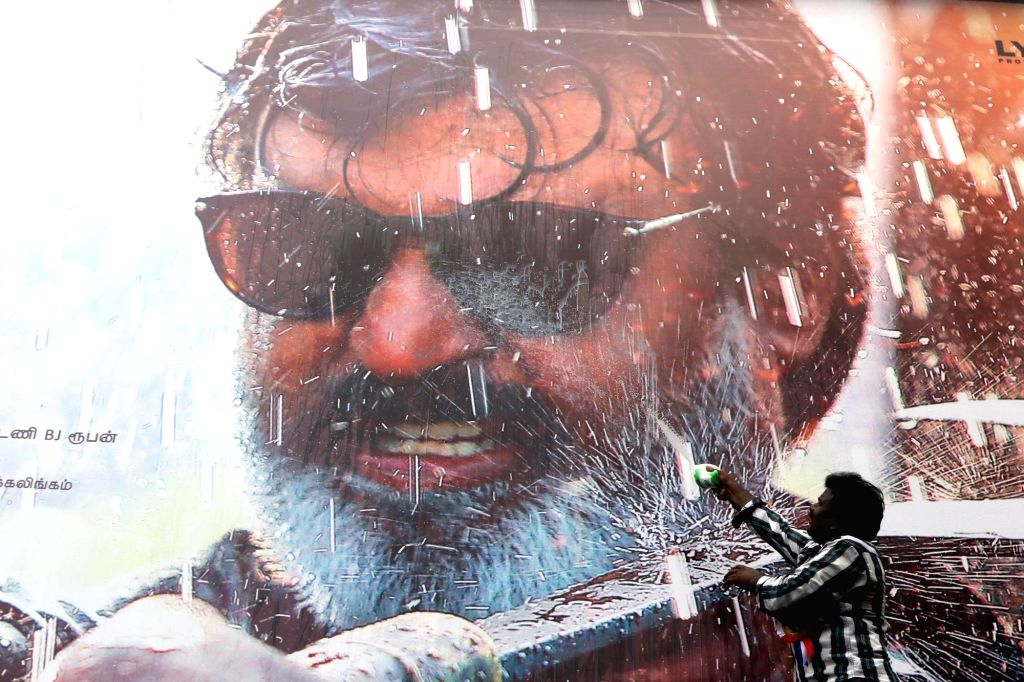 "Fans wash a poster of actor Rajinikanth with milk after release of his film ""Kaala"" in Chennai on June 7, 2018. - Rajinikanth"