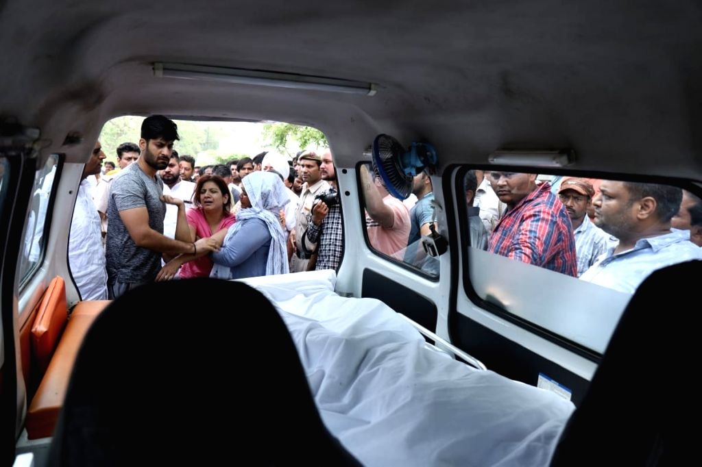 Faridabad: Bereaved family members of Haryana Congress leader Vikas Chaudhary, who was shot dead by two assailants outside a gym in Faridabad on June 27, 2019. (Photo: IANS) - Vikas Chaudhary
