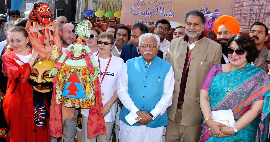 Haryana Chief Minister Manohar Lal Khattar and Haryana Tourism Minister Ram Bilas Sharma at the 29th Surajkund International Crafts Mela in Faridabad, Haryana on Feb 9, 2015. - Manohar Lal Khattar and Bilas Sharma