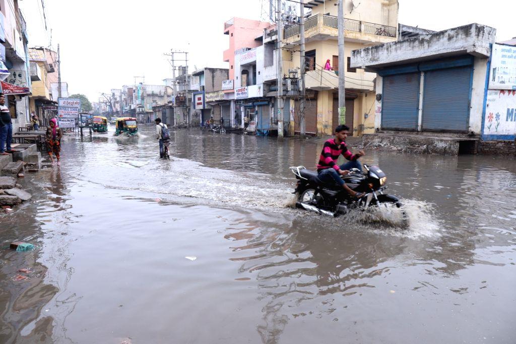 Faridabad: The waterlogged 60 Feet Road End located in Parvatiya Colony after heavy rains lashed Haryana's Faridabad on Dec 13, 2019. (Photo: IANS)
