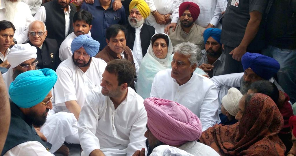 :Faridkot: Vice president Rahul Gandhi along with comgress laeders Captain Amarinder Singh and Partap Singh Bajwa meet the family members of Sikh Youth who died during the protest against the ... - Rahul Gandhi