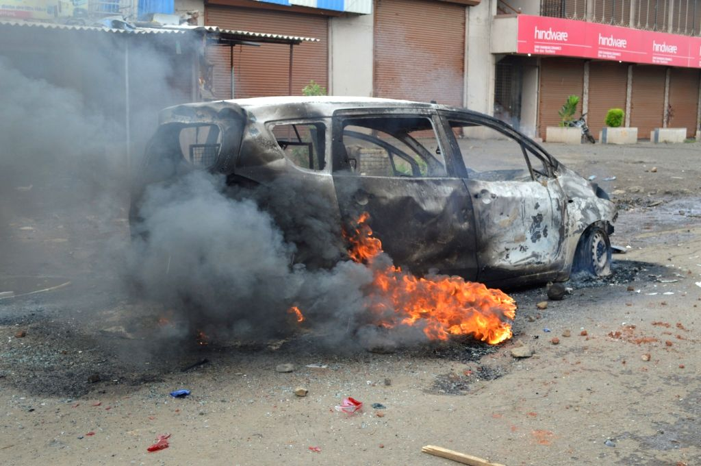 Farmers agitating against land acquisition torch a car near Kalyan in Maharashtra's Thane on June 22, 2017.