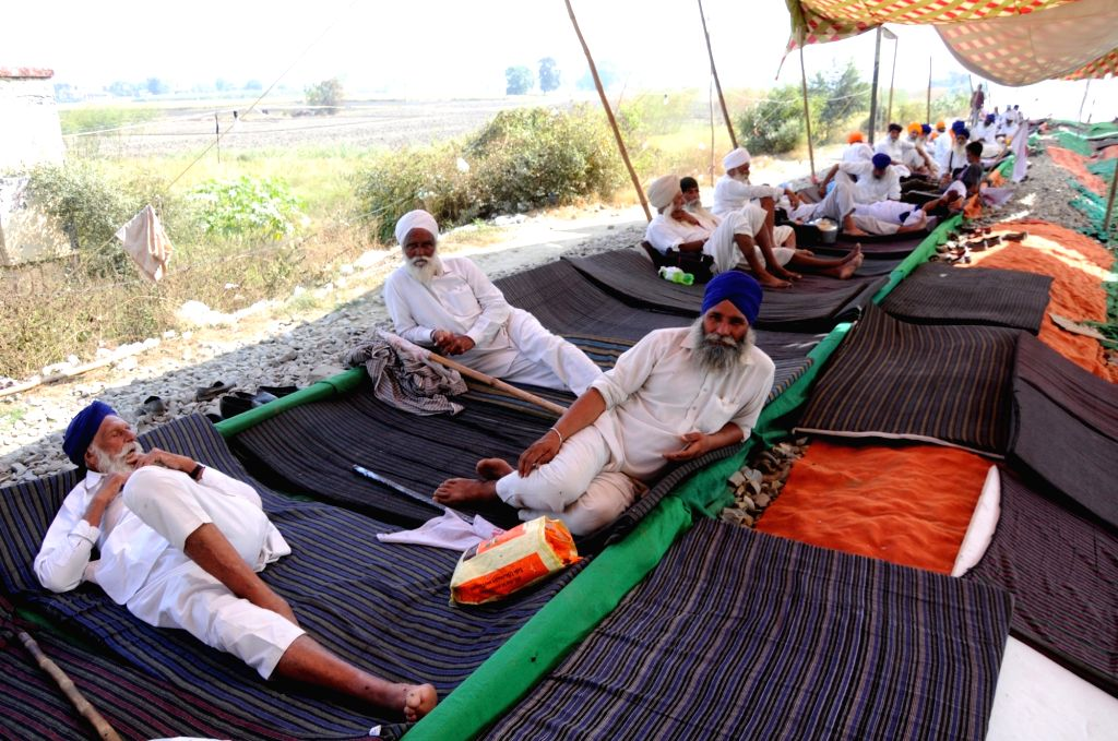 Farmers block railway tracks as they protest against the Narendra Modi-led Central Government over the contentious farm laws, on the outskirts of Amritsar on Oct 7, 2020. - Narendra Modi