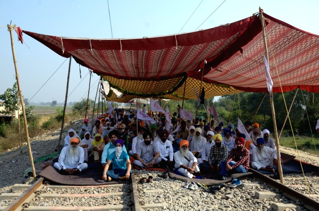 Farmers block railway tracks during their 'Rail Roko' protest against Farm Laws 2020, in Amritsar on Oct 24, 2020.