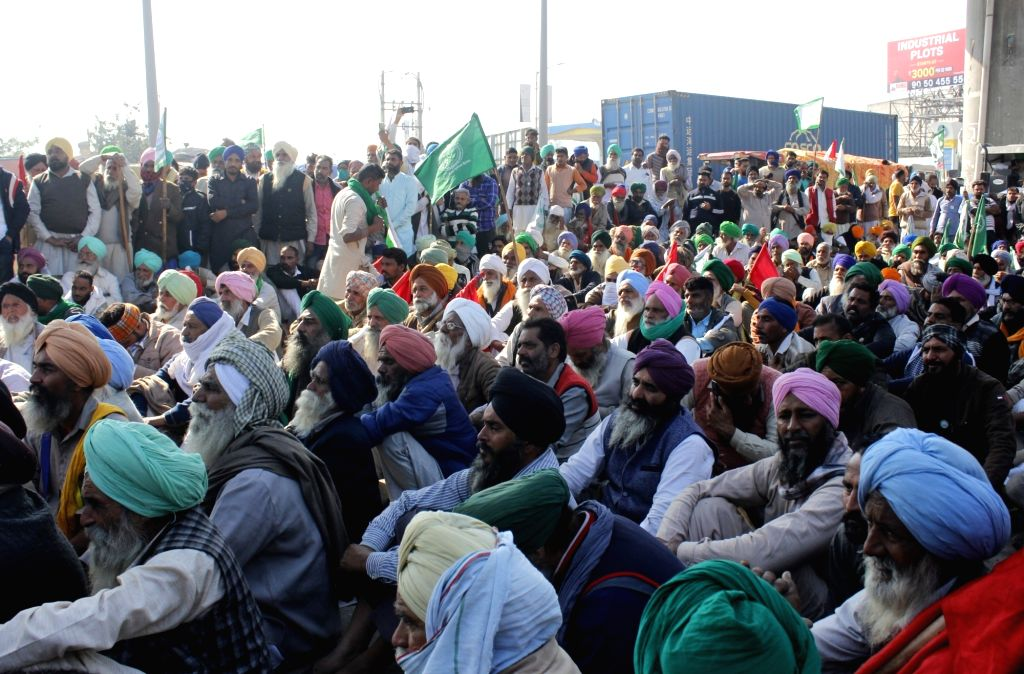 Farmers continue to protest against the Central Government's Farm Laws at Delhi-Haryana's Tikri border, on Nov 28, 2020.
