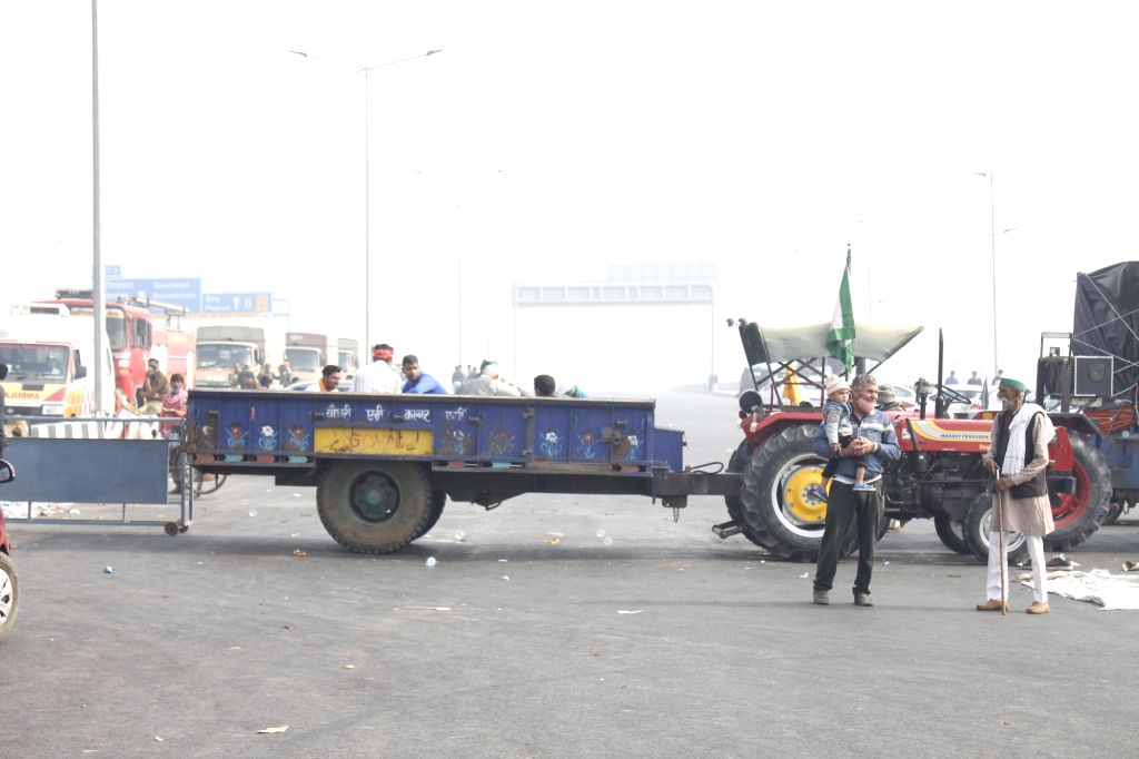 Farmers continue to protest against the Central Government's farm laws on the ninth day, on Delhi-Uttar Pradesh border near Ghazipur on Dec 4, 2020.