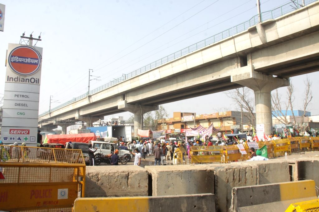Farmers from Punjab and Haryana continue to protest for the seventh consecutive day, against Central Government's new Farm Laws, at Delhi-Haryana's Tikri Border on Dec 2, 2020.