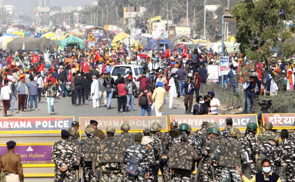 Farmers from Punjab and Haryana march to Delhi during their protest against Farm Laws 2020 amid high security, at Sindu Border in New Delhi on Nov 27, 2020. The Delhi Police put up ...