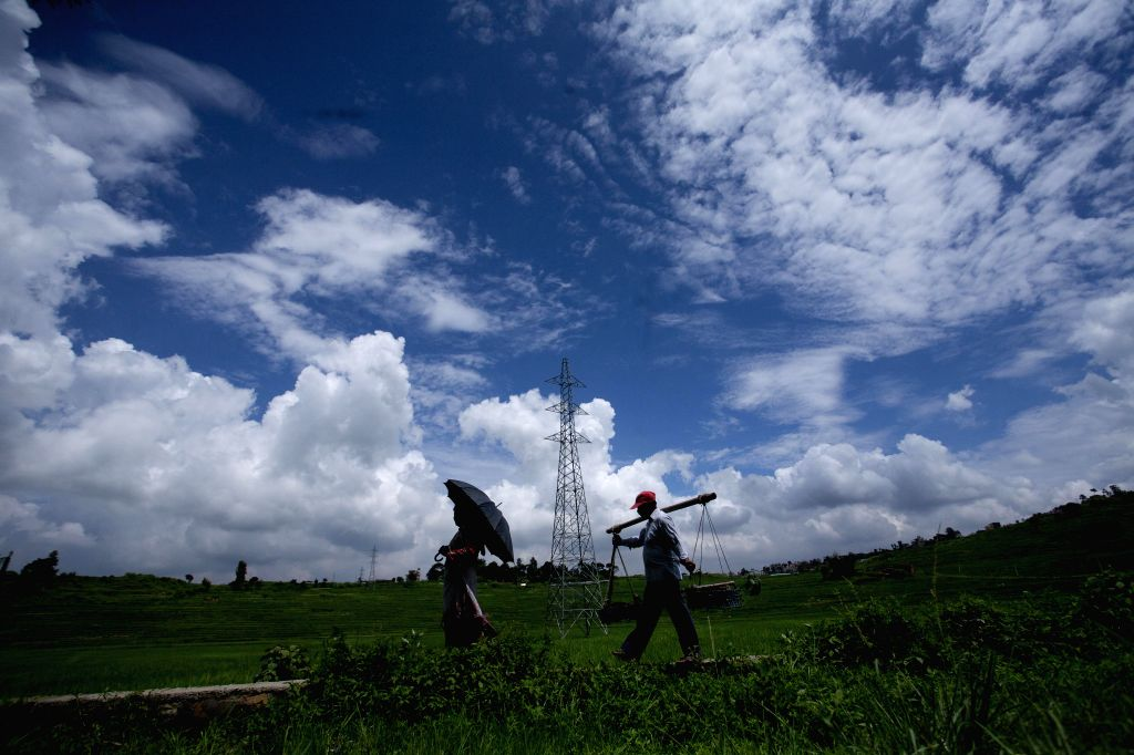 Farmers head towards a paddy field for work in Khokana, on the outskirts of Lalitpur, Nepal, Aug. 18, 2015. Agriculture is the major sector of Nepalese economy ...
