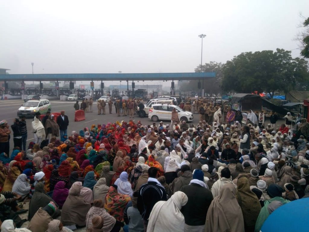 Farmers holding a meeting ahead of a protest rally near DND Flyway in Noida on Feb. 2, 2019.
