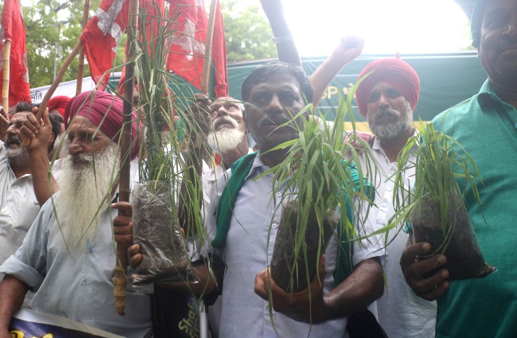 Farmers participate in a black flag march against the Central Government in New Delhi on July 20, 2018.