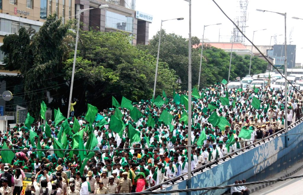 Farmers participate in a rally called by Karnataka Brashtachara Virodhipade (KBV) in association with different labour unions, pro-farmer organisations and local organisations to protest ...