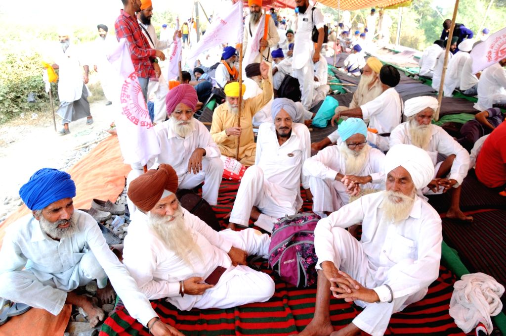 Farmers participate in 'Rail Roko' agitation as they stage a sit-in demonstration blocking railways tracks, against the three contentious agriculture-related Bills that have led to ...