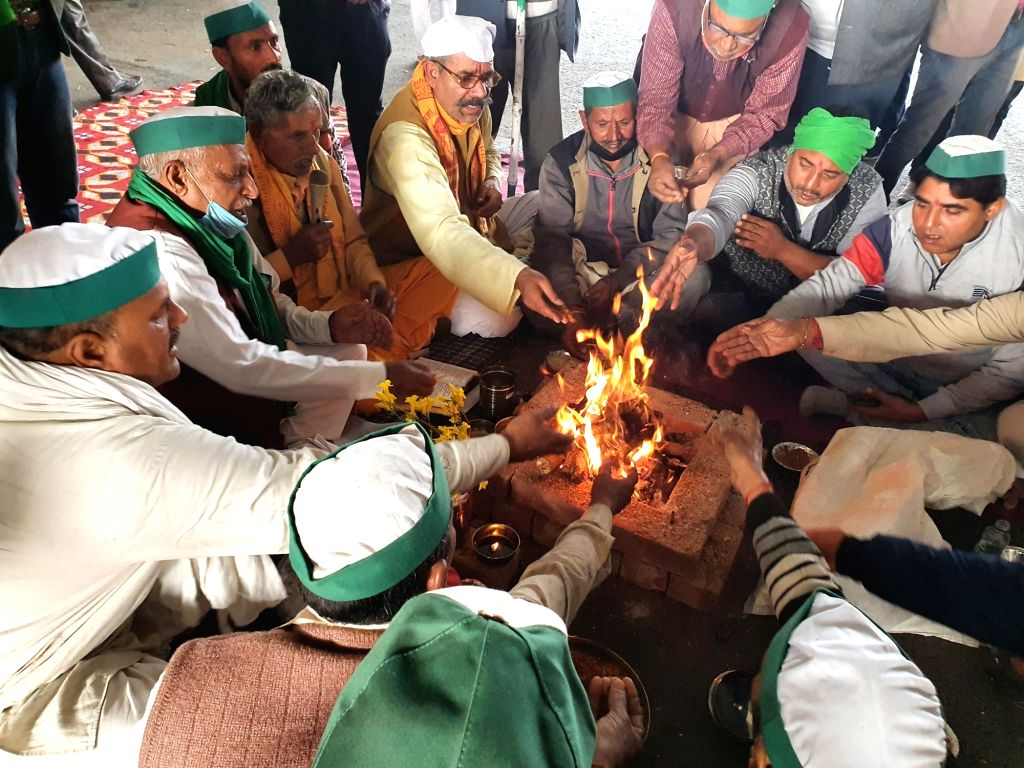Farmers perform havan at Ghazipur border to pray for happiness and peace.