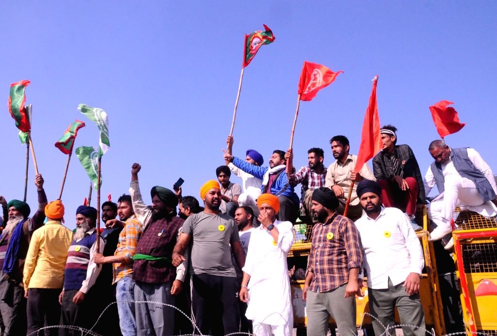 Farmers protest against the Central Government's Farm Laws at Delhi-Haryana's Singhu Border on Nov 28, 2020.