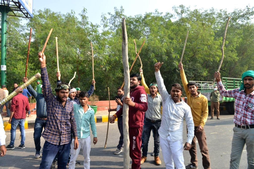 Farmers protest against the Central Government's new Farm Laws at the Noida-Delhi border on Dec 2, 2020.