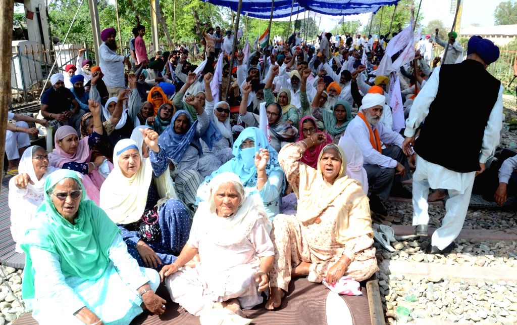 Farmers  protest during a nation-wide strike call given by various farmers' organizations as a protest to press further against the new agricultural laws introduced by the government and to ...