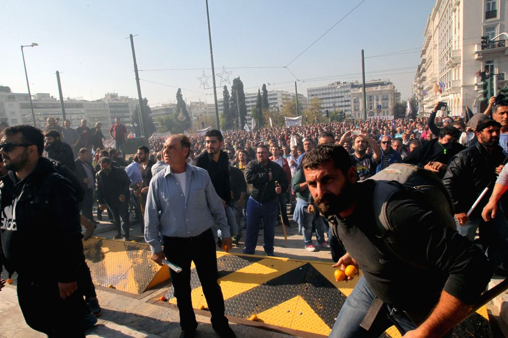 Farmers protesting against tax measures and changes in the social security system rally in front of the Parliament, in Athens, Greece, Nov. 18, 2015. (Xinhua/Marios ...