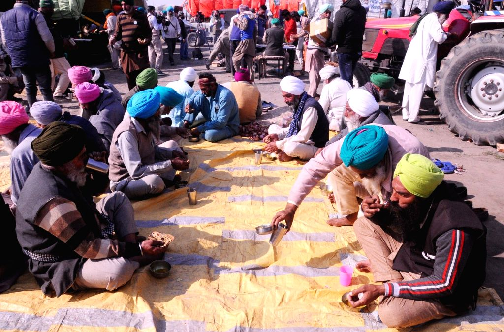 Farmers protesting against the Central Government's agricultural laws stage a sit-in demonstration at the Nirankari ground in Delhi's Burari area on Nov 28, 2020.