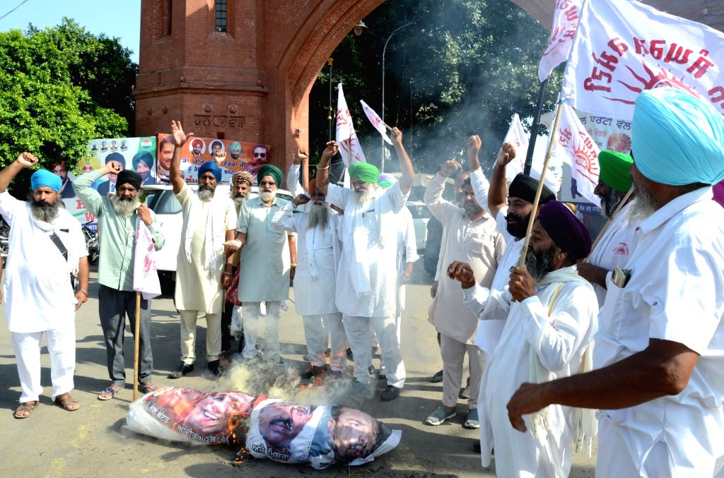 Farmers raise slogans as they burn an effigy of PM Narendra Modi during a protest against the Lakhimpur Kheri incident,in Amritsar on Monday october 04,2021. - Narendra Modi