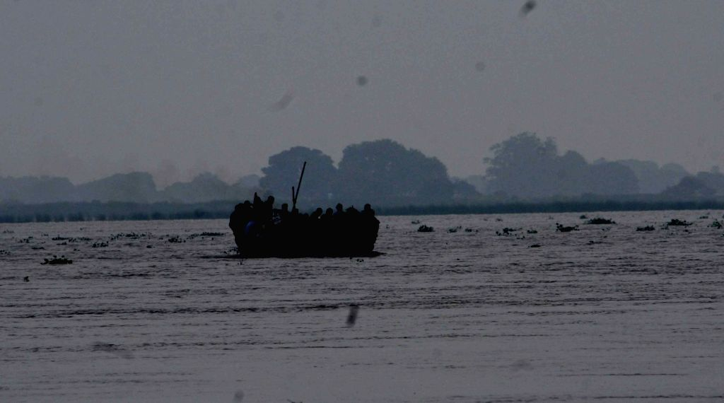 Farmers sail through the swollen Ganga river with their produce from the flooded Diara area of Bihar's Danapur to the market after rise in the water levels of Ganga following heavy rains, on ...