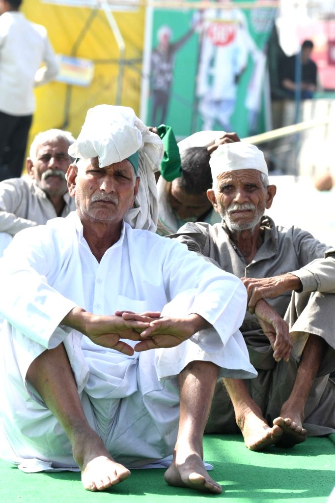 Farmers sitting at the demonstration site during the ongoing farmers protest against the new farm laws at Ghazipur Border, New Delhi on Wednesday, 24th February 2021.