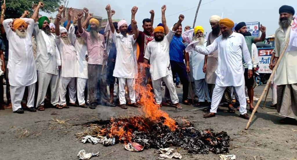 Farmers stage a demonstration against Prime Minister Narendra Modi over the proposed Regional Comprehensive Economic Partnership (RCEP) agreement, at Khasa on the outskirts of Amritsar on ... - Narendra Modi