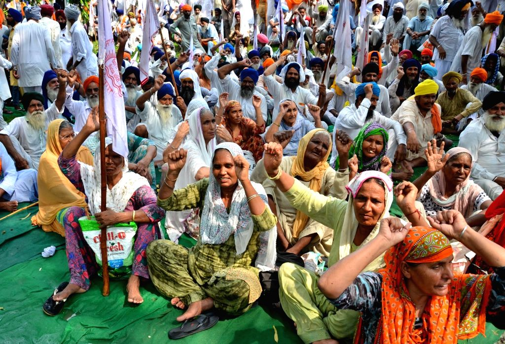 Farmers stage a sit-in demonstration, demanding the State Government to revise inflated electricity bills and pressed for reduction in dues of electricity bills of the irrigation projects ...