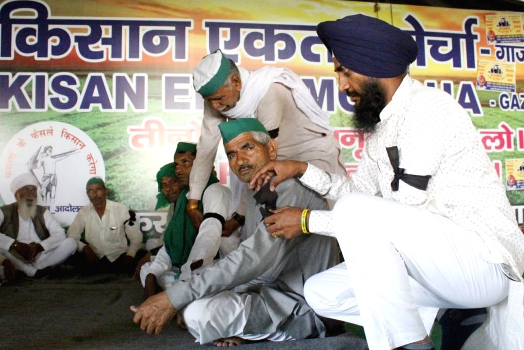 Farmers to mark 100-days protest with black band at Ghazipur border in New Delhi on Saturday 06 March 2021.