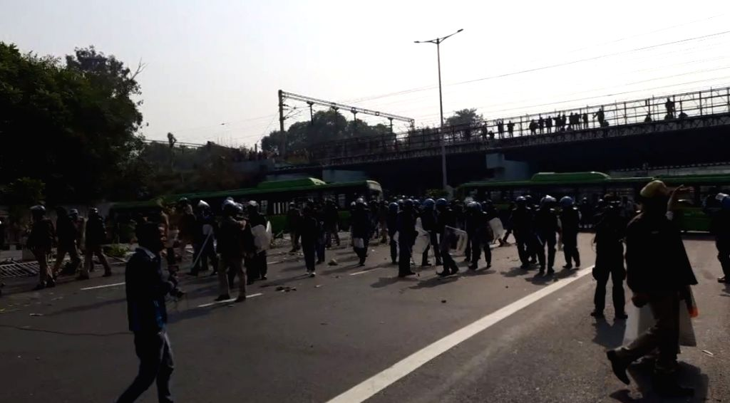 Farmers' tractor rally turns violent near ITO, police resort to lathi charge.