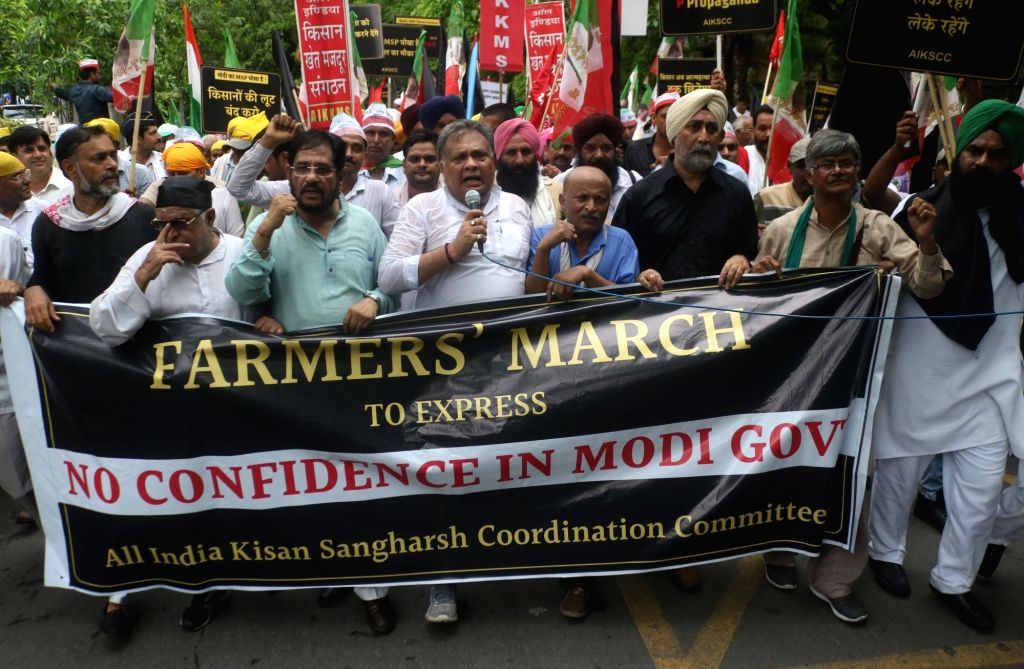 Farmers under the aegis of All India Kisan Sangharsh Coordination Committee (AIKSCC) participate in a black flag march against the Central Government in New Delhi on July 20, 2018.