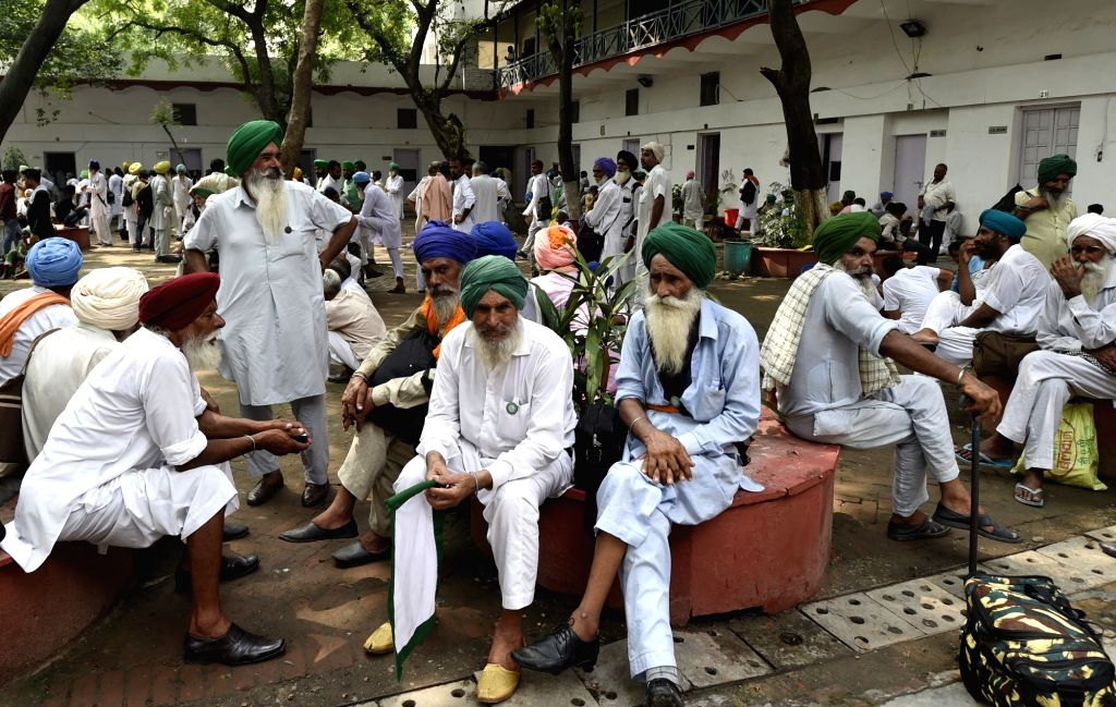 Farmers who were staging a demonstration near Niti Aayog to press for implementation of Swaminathan Commission Report detained at Parliament Street Police Station in New Delhi on July 3, ...