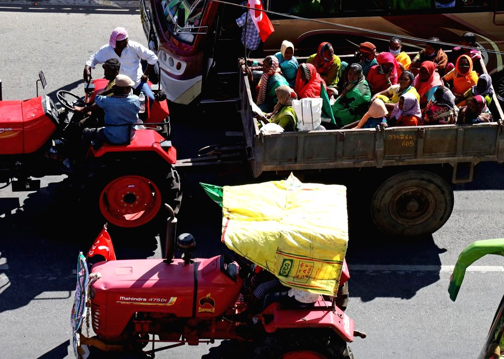 Farmers with their family members and various organisations leaders take part in a tractor parade to support the farmers protesting at Delhi borders amid 72nd Republic Day celebrations , ...