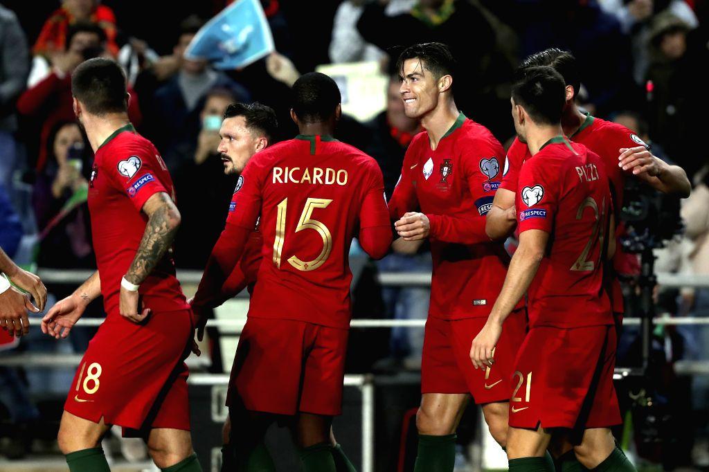 FARO, Nov. 15, 2019 - Cristiano Ronaldo (3rd R) of Portugal celebrates during the group B match against Lithuania at the UEFA Euro 2020 qualifier at the Algarve stadium in Faro, Portugal, Nov. 14, ...