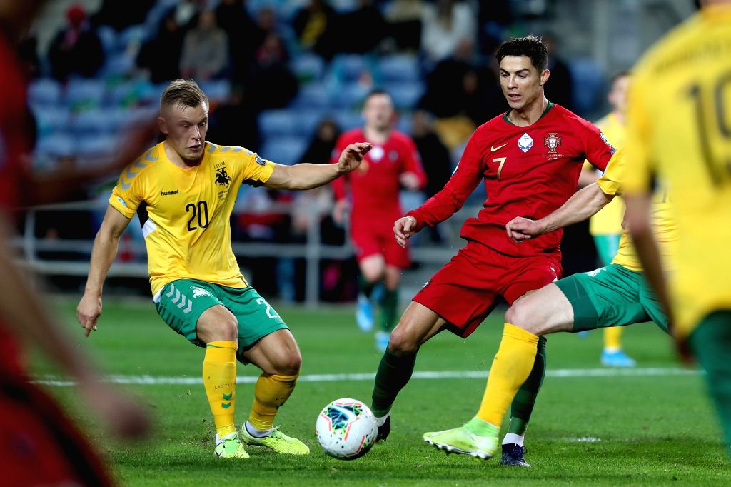 FARO, Nov. 15, 2019 - Cristiano Ronaldo (R) of Portugal vies with Domantas Simkus of Lithuania during the group B match at the Euro 2020 qualifier at the Algarve stadium in Faro, Portugal, Nov. 14, ...