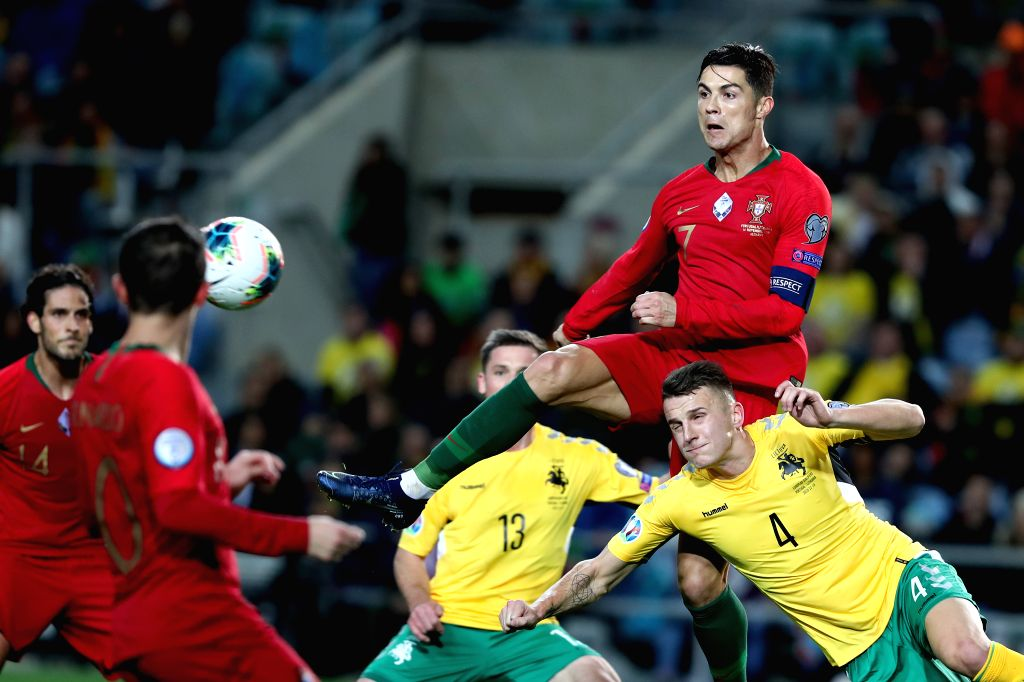 FARO, Nov. 15, 2019 - Cristiano Ronaldo (Top) of Portugal competes during the group B match against Lithuania at the UEFA Euro 2020 qualifier at the Algarve stadium in Faro, Portugal, Nov. 14, 2019.